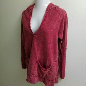 Maroon hooded tunic pockets